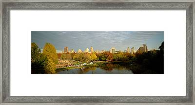 Park With Buildings In The Background Framed Print by Panoramic Images