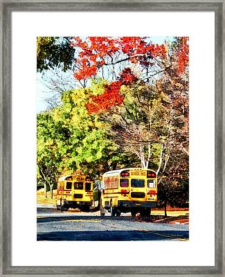 Parked School Buses Framed Print by Susan Savad