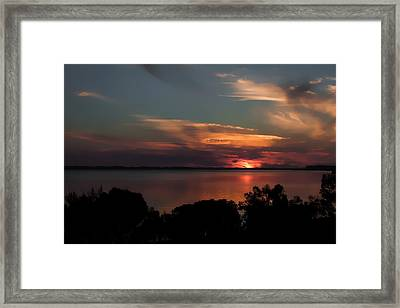 Partial Eclipse Sunset Framed Print by Debra Forand