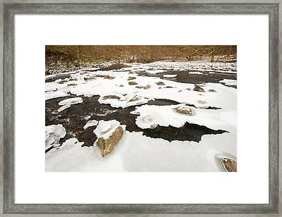 Partially Frozen River Framed Print by Ashley Cooper