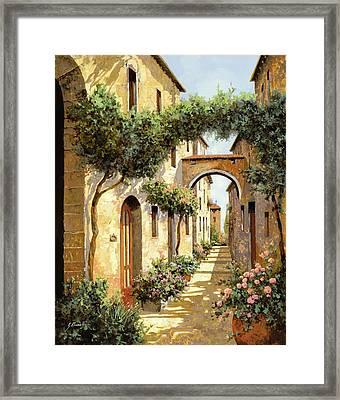 Passando Sotto L'arco Framed Print by Guido Borelli
