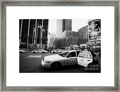 Passenger Gets Out Of Rear Door Of Yellow Taxi Cab On 7th Avenue New York City Usa Framed Print by Joe Fox