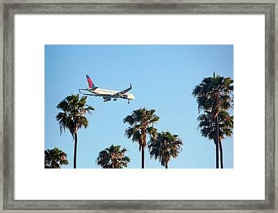 Passenger Jet Airliner Landing Framed Print by Jim West