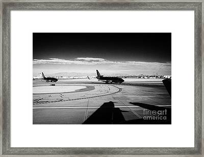 passenger jets waiting in line to take off at McCarran International airport Las Vegas Nevada USA Framed Print