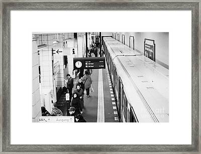 passengers along ubahn train platform Friedrichstrasse Friedrichstrasse u-bahn station Berlin Framed Print by Joe Fox