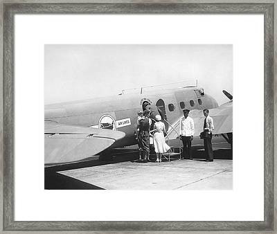 Passengers Boarding Airplane Framed Print by Underwood Archives