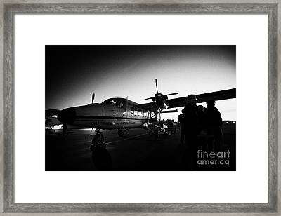 Passengers Boarding Early Morning Dehaviland Twin Otter Light Aircraft Flight To Grand Canyon At Bou Framed Print by Joe Fox