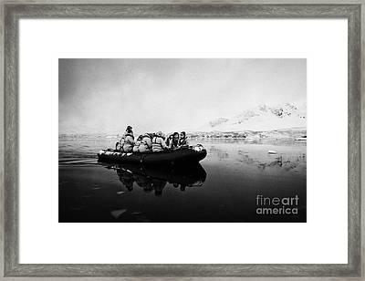 Passengers On Board A Zodiac In Fournier Bay On Excursion In Antarctica Framed Print by Joe Fox