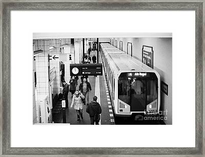 passengers on ubahn train platform as train leaves Friedrichstrasse u-bahn station Berlin Germany Framed Print by Joe Fox