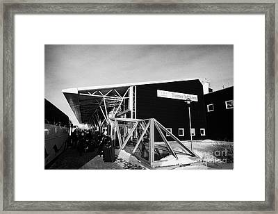 passengers with luggage get off coach at Tromso airport troms Norway Framed Print by Joe Fox