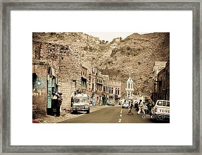 Passing Through A Village Framed Print by Charuhas Images