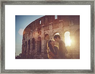 Passionate Kiss In Front Of The Coliseum Framed Print by Piola666