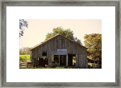 Patched Crumbling Barn Framed Print by Linda Phelps
