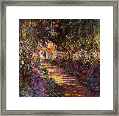 Pathway In Monets Garden In Giverny Framed Print by Claude Monet