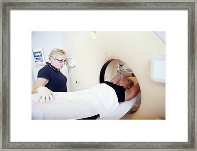 Patient In A Ct Scanner Framed Print by Thomas Fredberg