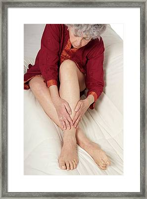 Patient Nursing A Sore Ankle Framed Print by Lea Paterson