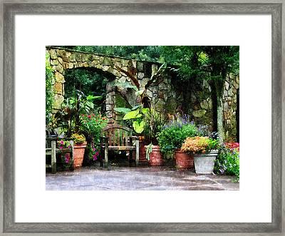 Patio Garden In The Rain Framed Print by Susan Savad