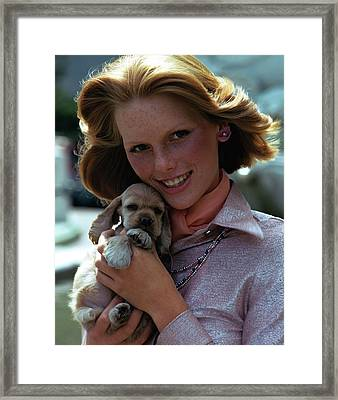 Patti Hansen Carrying A Puppy Framed Print by William Connors