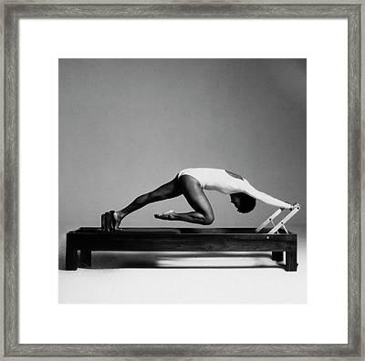 Paula Kelly Exercising On The 'reformer' Machine Framed Print