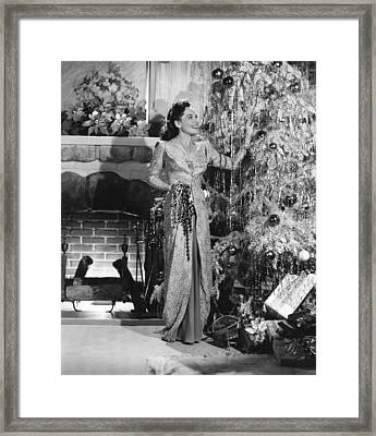 Paulette Goddard Decorating Framed Print by Everett