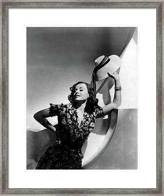 Paulette Goddard Holding A Straw Hat Framed Print by Horst P. Horst