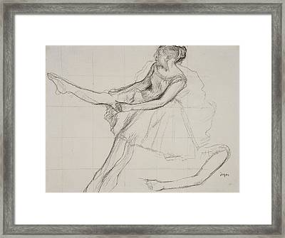 Dancer Adjusting Her Tights Framed Print by Edgar Degas