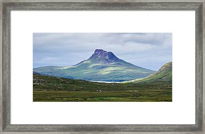 Peak Of A Mountain Under A Cloudy Sky Framed Print