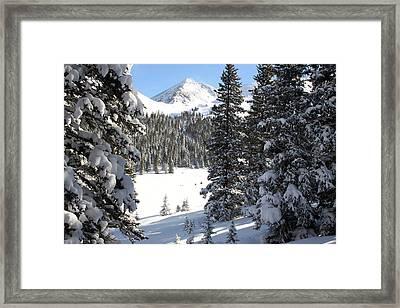 Peak Peek Framed Print
