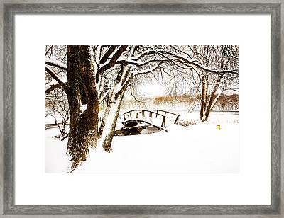 Peaks Snow Bridge Framed Print by Mark East