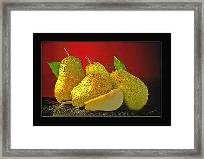 Pears On Red Background Framed Print by Ed Hoppe