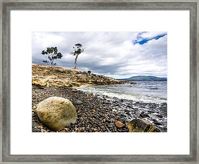 Pebbled Beach Under Dramatic Skies Number One Framed Print by Kaleidoscopik Photography