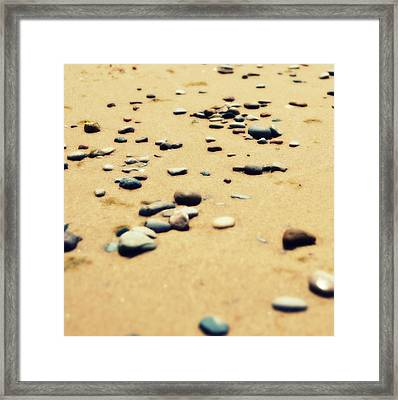 Pebbles On The Beach Framed Print by Michelle Calkins