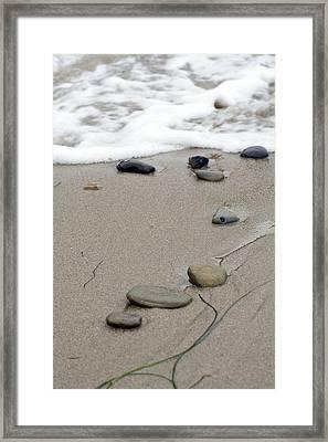 Pebbles On The Beach Framed Print
