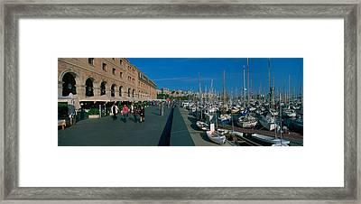 Pedestrian Walkway Along A Harbor Framed Print