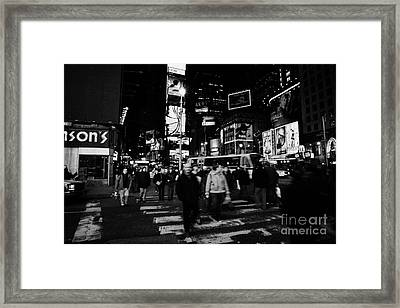 Pedestrians Crossing Crosswalk In Times Square In Nighttime New York City Framed Print by Joe Fox