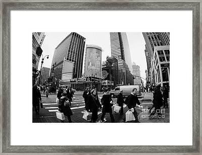 Pedestrians Crossing Crosswalk On 7th Ave And 34th Street Outside Macys New York City Usa Framed Print by Joe Fox