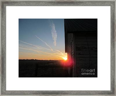 Peeking Through The Barn Sunrise Framed Print by Tina M Wenger