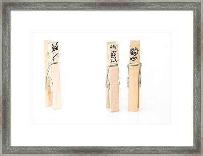 peg concept. Jealous man look on at happy couple Framed Print by Fizzy Image