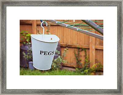 Pegs Holder Framed Print by Tom Gowanlock