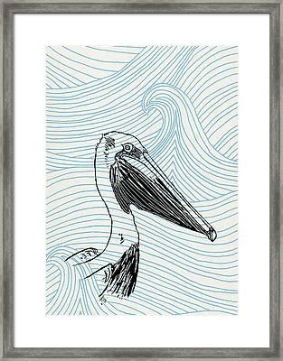 Pelican On Waves Framed Print
