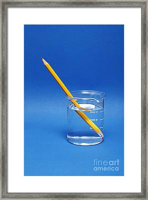 Pencil In A Beaker With Water Framed Print by GIPhotoStock