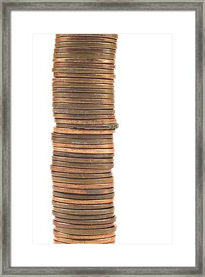 Pennies Stacked On White Background Framed Print by Keith Webber Jr