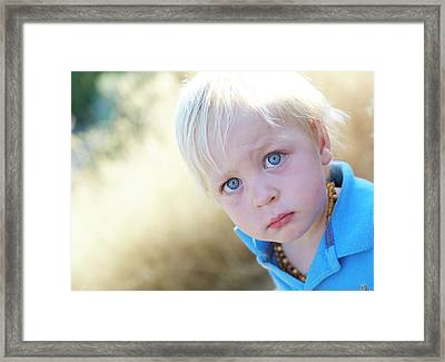Pensive Boy Looking Towards Camera Framed Print by Ruth Jenkinson