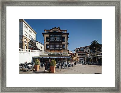 People At Sidewalk Cafe In Town Square Framed Print