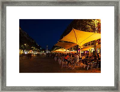 People At Sidewalk Cafes In A City Framed Print
