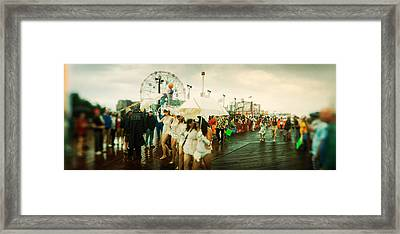 People Celebrating In Coney Island Framed Print