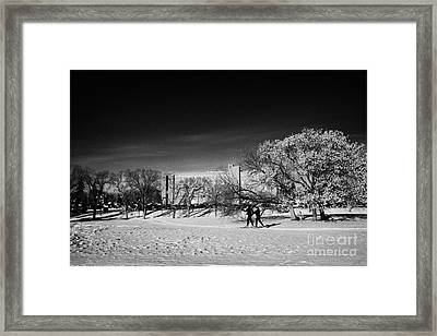 people cross country skiing in kinsmen park Saskatoon Saskatchewan Canada Framed Print by Joe Fox