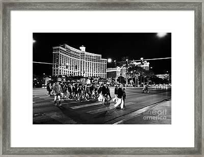 People Crossing Las Vegas Boulevard Outside The Bellagio At Night Nevada Usa Framed Print by Joe Fox