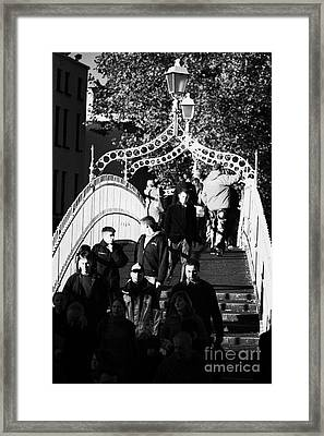 People Crossing The Hapenny Ha Penny Bridge Over The River Liffey In Dublin At A Busy Time Vertical Framed Print by Joe Fox