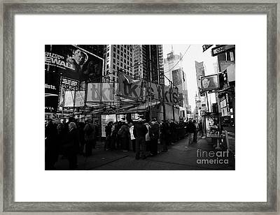 people customers queuing outside the tickets TKTS booth in times square new york city Framed Print by Joe Fox